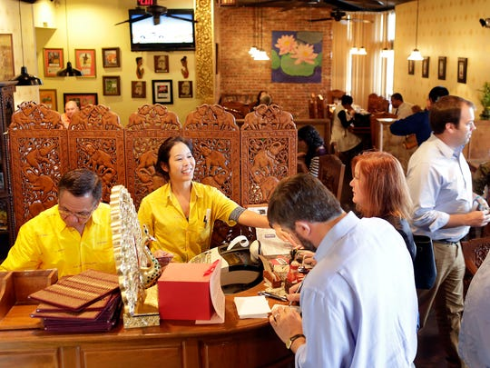 Thai House owner Watt Bunniran, left, and daughter Su check out customers during a lunch rush at the Thai House in Jackson. The Thai House, which opened in 1992, closed in fall 2016.