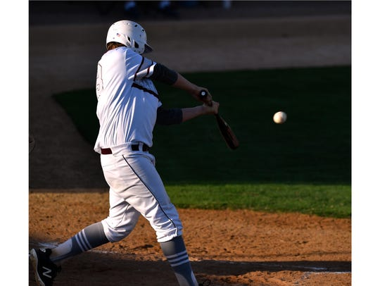 Hawley's Quay Stokes gets a hit during Thursday's loss to New Deal.