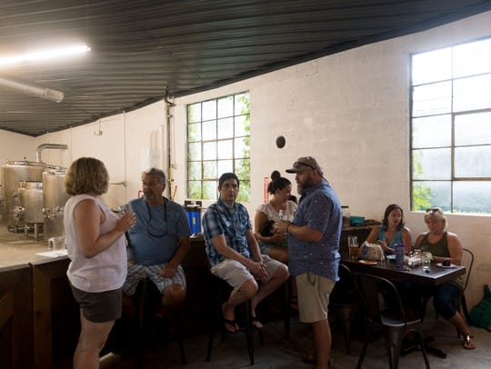 Guests gather for drinks at Printshop Beer Co. on Sunday,