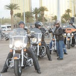 Harley Owners Group members rev their engines to signal the ground shaking for the new Las Vegas Harley-Davidson dealership on the Las Vegas Strip.