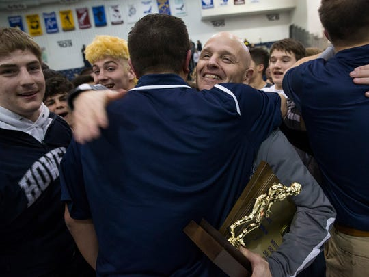 Howell Coach John Gagliano celebrates Howell's State Title with coaches and players. Hunterdon Central vs Howell for NJSIAA Public  Group V Team Wrestling Championship  in Toms River, NJ on February 12, 2017