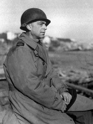 Journalist Ed Kennedy wears a metal helmet in this March 1944 photo made at the Anzio beachhead in Italy. Kennedy became famous as the AP war correspondent who bypassed military censors and broke the news that World War II was over.