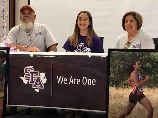 Central High School's Bailey Kinney, center, her father