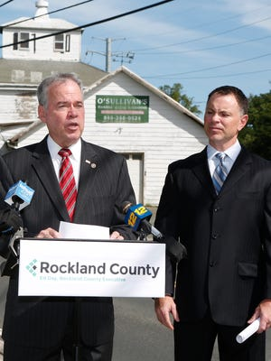 County Executive Ed Day, left, and Rockland County Title Examiner Thomas Dillon speak to the press near a property which is in the process of being foreclosed on by the county in Valley Cottage on Wednesday, September 21, 2016.