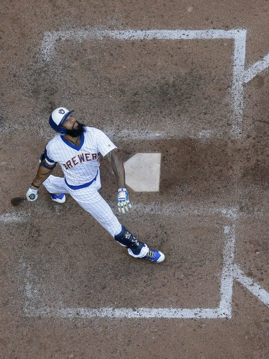 Milwaukee Brewers' Eric Thames looks up at his pop up to end the ninth inning of a baseball game against the Philadelphia Phillies Sunday, July 16, 2017, in Milwaukee. The Phillies won 5-2. (AP Photo/Morry Gash)