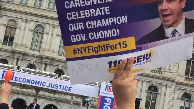 Union members held signs supporting Gov. Andrew Cuomo as he spoke at a minimum wage rally outside the state Capitol on March 15, 2016.