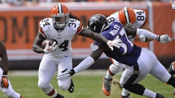 Cleveland Browns rookie Isaiah Crowell, here trying to elude former Alabama linebacker C.J. Mosley, has three rushing touchdowns in four games this season.