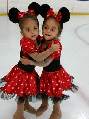 """Twins Mnemosyne and Penelope Acosta, 2, will play duplicate """"Minnie Mouse characters"""" during Space Coast IcePlex's """"A Festival of Fantasy with Mickey and Friends."""""""