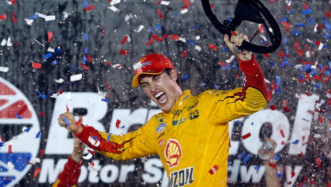 Sprint Cup Series driver Joey Logano (22) celebrates winning the Irwin Tools Night Race at Bristol Motor Speedway.