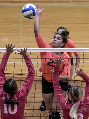 Garden City High School's Melody Flores goes up for a kill against Dodge City earlier this season. The Buffaloes advanced to the Class 6A Final Four with a win on the road Tuesday at Derby.