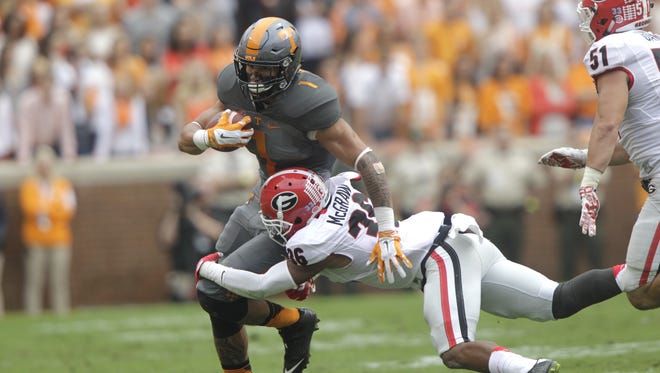 Tennessee running back Jalen Hurd (1) is hit by Georgia defensive back Rico McGraw (36) in 2015.