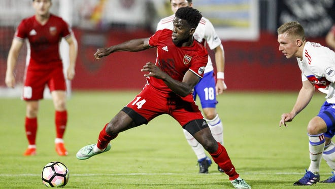 Phoenix Rising FC forward Jason Johnson (14) dribbles against Toronto FC II defenders early this year. He scored a goal against Sacramento to help keep Phoenix in the USL playoff hunt.