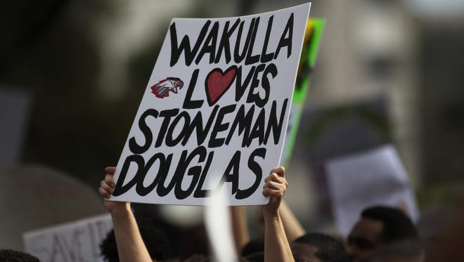 Locals show their support for Stoneman Douglas High School at the #NeverAgain Rally on Feb. 21, 2018.
