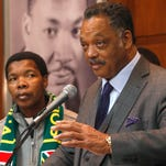 Rev. Jesse Jackson Sr., right, and Catholic priest Thukni Magwaza, from South Africa, talk about the life of Nelson Mandela before a prayer vigil in honor of Mandela at the Rainbow Push Coalition headquarters on Dec. 6, 2013, in Chicago.