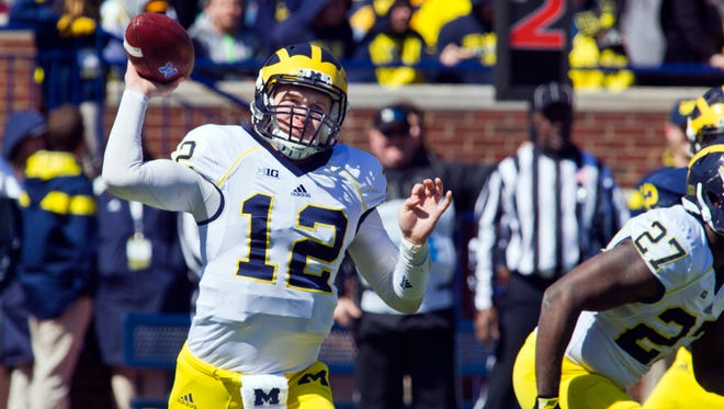 Michigan quarterback Alex Malzone throws a pass during the spring game in Ann Arbor on April 4, 2015.