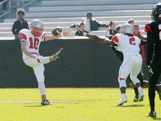 B.T. Potter boots a punt during South Pointe High School's