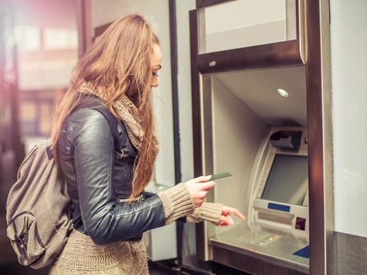 atm-bank-cash-woman-getty_large.jpg