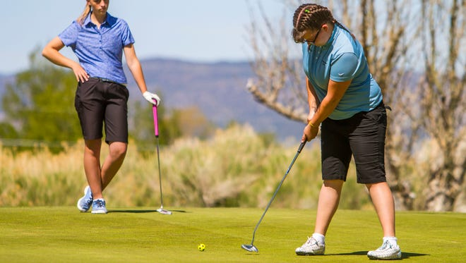Canyon View golfer Keslee Sherman follows through on a putt in this file photo.