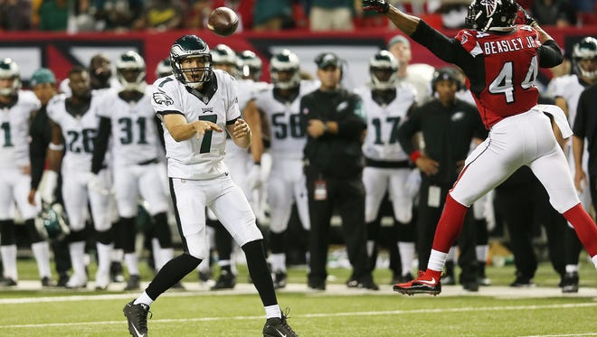 Eagles quarterback Sam Bradford throws as Falcons linebacker Vic Beasley defends on Monday night.