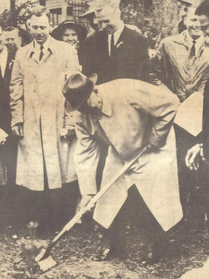 """President Eisenhower planting the """"Liberty Tree"""" at his mother's birthplace in Fort Defiance."""