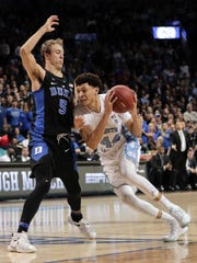 North Carolina forward Justin Jackson (44) drives against Duke guard Luke Kennard (5) in the second half of an NCAA college basketball game during the semifinals of the Atlantic Coast Conference tournament, Friday, March 10, 2017, in New York. (AP Photo/Julie Jacobson)