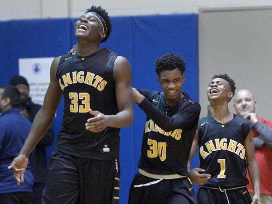 Kobe Long (30) and Anthony Iglesia (1) no longer have the powerful presence of Isaiah Stewart (33) in the post for the McQuaid Knights.