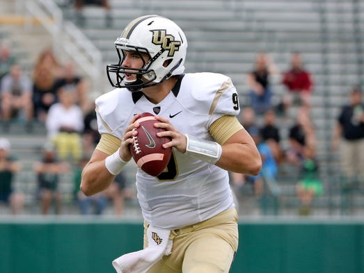 UCF quarterback Bo Schneider, 9, looks to throw against
