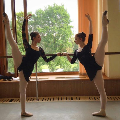 Cassidy McMurrian, right, and her roommate Jillian Smith, 16, practice while studying at the Bolshoi Ballet Academy in Moscow, Russia, this past summer.