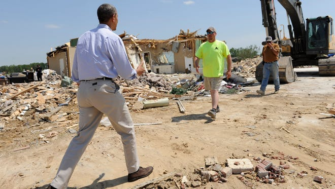 President Barack Obama tours tornado-damaged areas of Vilonia, Ark., on Wednesday, May 7, 2014, and greets residents of the area. Obama is visiting with first responders and families affected by the recent tornados before traveling on to California where he will raise money for the Democratic Party and receive an award from a foundation created by movie director Steven Spielberg.