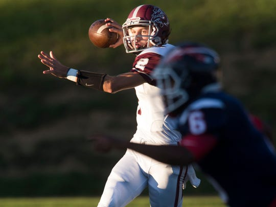 Bearden's Collin Ironside looks for an open receiver during the game against South-Doyle on Thursday, September 7, 2017.