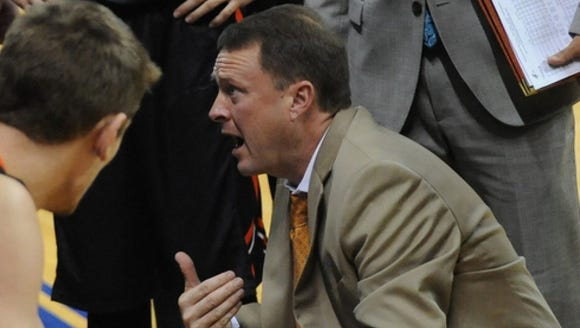 Mike Jones, right, a college coach for 25 years, is