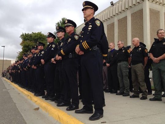 Law enforcement officers from around the state arrive at Montana ExpoPark Thursday to pay their respects to fallen Cascade County Deputy Joe Dunn.