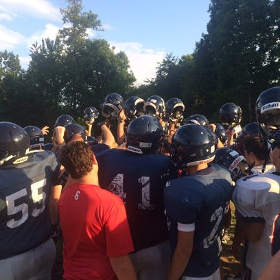 The Creek Wood Red Hawks huddle up before breaking off into drills