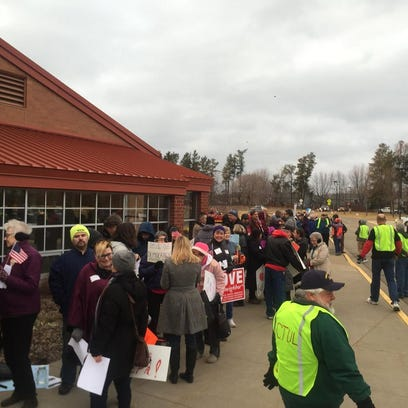Protesters gather in advance of Emmer's town hall