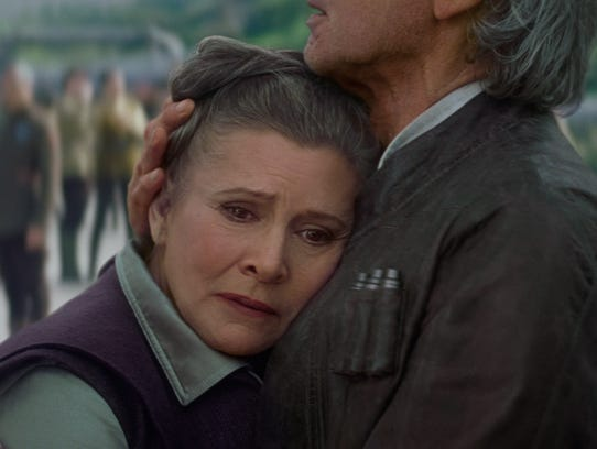 Leia (Carrie Fisher) is comforted by Han Solo (Harrison