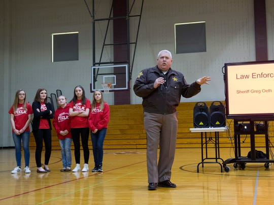 Posey County Sheriff Greg Oeth addresses the Mount Vernon Junior High School student body at the iBuckleUP weBuckleUP assembly at the school Friday afternoon.