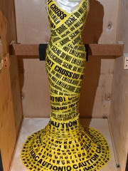 """Crime Scene"" is part of the ""ReDress: Upcycled Style by Nancy Judd"" exhibition at the Farmington Museum at Gateway Park."