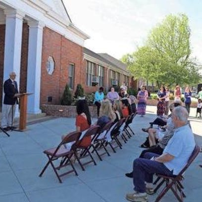 A crowd gathers outside Simpsonville's historic old