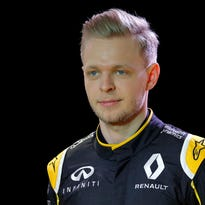Kevin Magnussen poses during the presentation of the