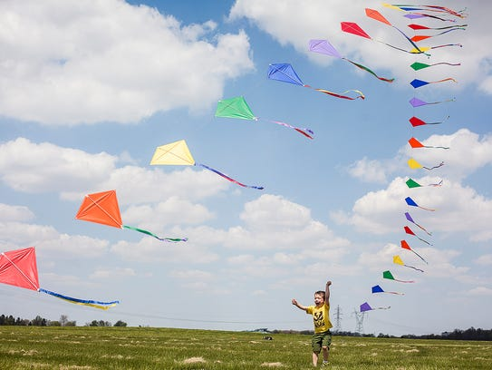 A string of kites is picked up by a gust of wind during the Ansel Toney Kite Festival at the Academy of Model Aeronautics in 2015.