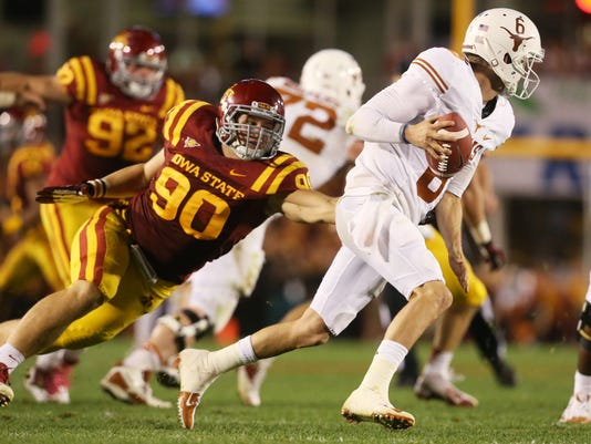 FILE - In this Oct. 3, 2013, photo, Iowa State defensive lineman Mitchell Meyers (90) chases Texas quarterback Case McCoy out of the backfield during an NCAA college football game in Ames, Iowa. Meyers spent a year away from football to battle cancer. Now healthy, Meyers could start for the Cyclones this season. (AP Photo/The Des Moines Register, Charlie Litchfield)