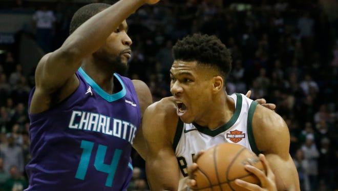 Charlotte Hornets forward Michael Kidd-Gilchrist is unable to stop Milwaukee Bucks forward Giannis Antetokounmpo from scoring with a minute to go.