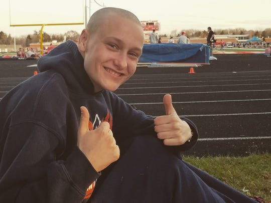 Kalena Clauer gives the thumbs up after a track and field meet with her high school in April.