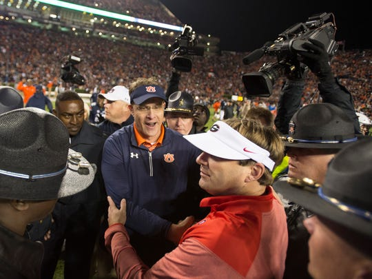 Auburn head coach Gus Malzahn greets Georgia head coach