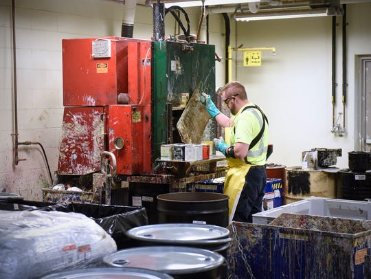 Ross Detert operates a machine in the recycling process