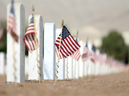 Over 1,000 volunteers decorated the Fort Bliss National Cemetery with American flags on every one of the 40,000 headstones.