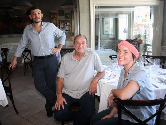Anjelica's owner Raymond Lena (center) with his daughter Anjelica Lena and her boyfriend, Matias Britos, who run the restaurant, in 2015.