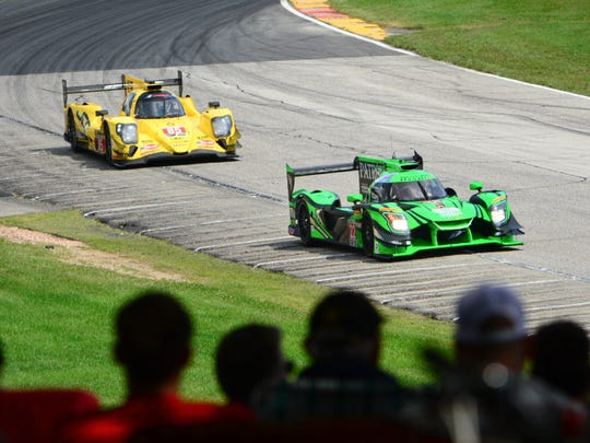 Pipo Derani leads Stephen Simpson out of Turn 5 and up the hill to Road America's Turn 6 during the Continental Tire Road Race Showcase on Sunday.