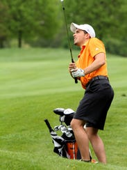 Brighton's Andrew Goble chips onto the green at Oak