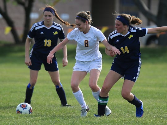 PCA sophomore defender Crystal Bock (8) maneuvers between